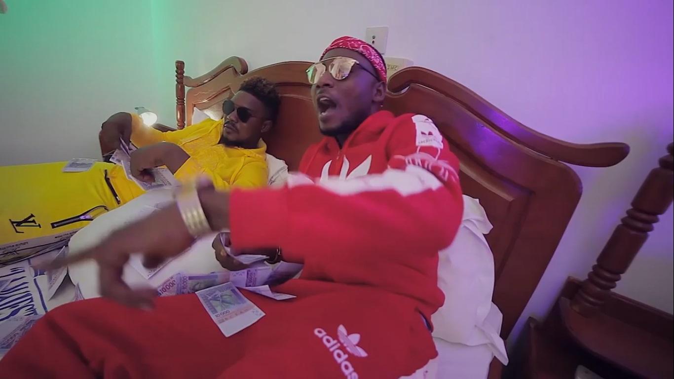 Mr Koomy ft Nasso – Owo guidi l'akpo (Clip Officiel)